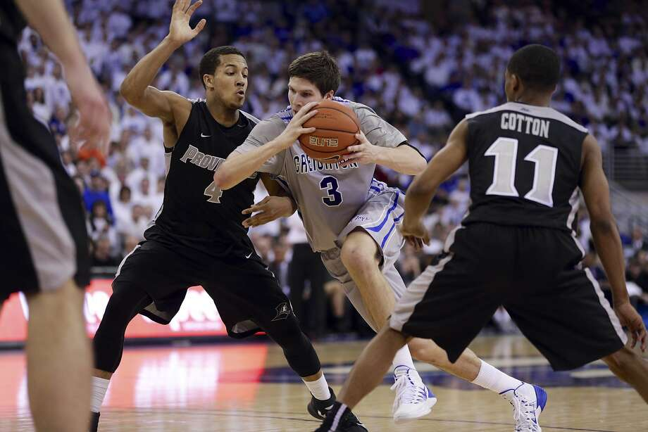Creighton's Doug McDermott (with ball) ranks seventh on the Division I all-time scorers' list. Photo: Nati Harnik, Associated Press