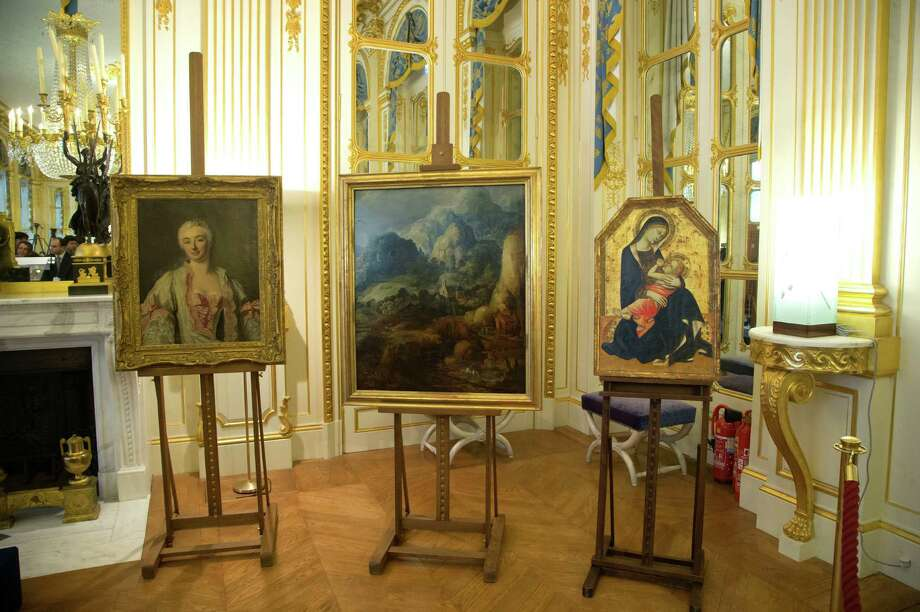 "The three returned masterpieces include ""Portrait of a Woman,""  left, ""Mountain Landscape"" and ""Madonna and Child."" They are shown at the Culture Ministry in Paris on Tuesday. ""Madonna and Child"" belongs to a Jewish Romanian banker who is the great-grandfather of Houston's Nick Florescu. Photo: Michel Euler, Associated Press / AP"