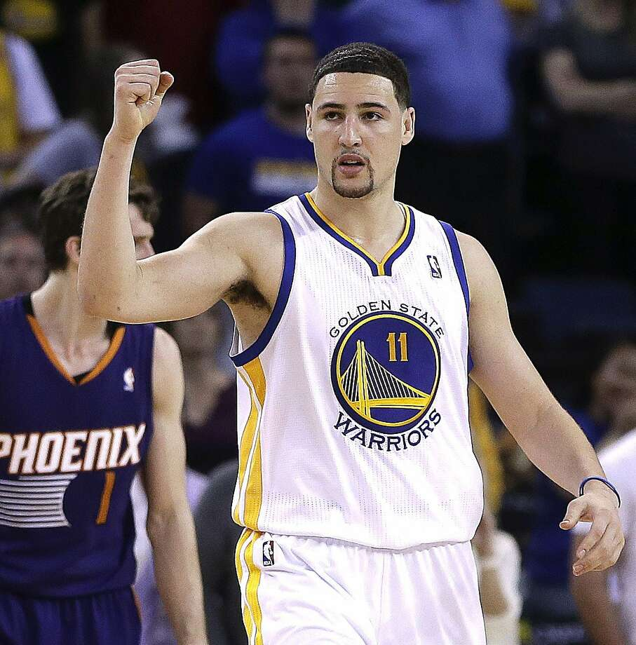 Golden State Warriors' Klay Thompson (11) celebrates a score against the Phoenix Suns during the second half of an NBA basketball game Sunday, March 9, 2014, in Oakland, Calif. (AP Photo/Ben Margot) Photo: Ben Margot, Associated Press