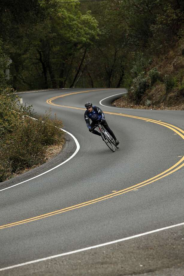 Bicyclists like this one on Highway 29 in Yountville will soon have a safer, mostly parallel trail that they will share with pedestrians. Photo: Sarah Rice, Special To The Chronicle