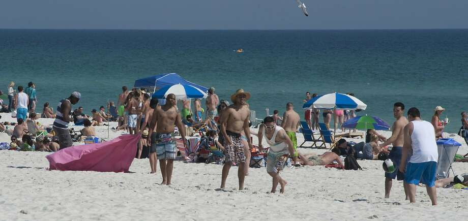 In this photo taken on Monday, March 10, 2014, warm weather draws spring beakers and locals to Pensacola Beach at Pensacola Beach in Pensacola, Fla. Photo: Tony Giberson, Associated Press