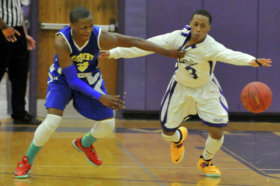 Harding's Terrence Rogers pulls Weshill's CJ Donaldson away from the loose ball during their Class LL basketball game at Westhill High School in Stamford, Conn., on Tuesday, March 11, 2014. Harding won, 66-61. Photo: Jason Rearick / Stamford Advocate