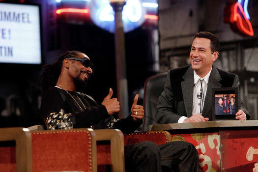 """Jimmy Kimmel interviews rapper/actor Snoop Dogg on Monday, March 10, 2014, for the first show of a week of """"Jimmy Kimmel Live"""" broadcasts from  Austin. Photo: Randy Holmes, ABC Via Getty Images / 2014 American Broadcasting Companies, Inc."""