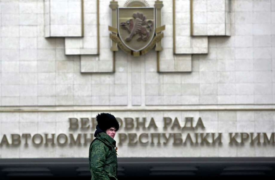 "Crimea's regional legislature in Simferopol, Ukrain, on Tuesday adopted a ""declaration of independence of the Autonomous Republic of Crimea."" Photo: Vadim Ghirda, STF / AP"
