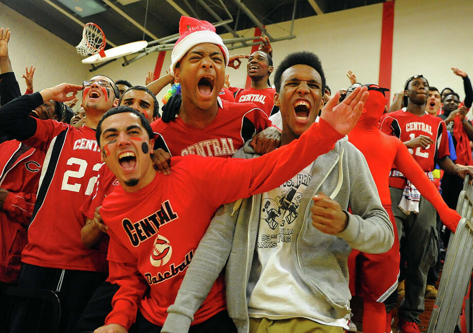 Central fans react as the team scores, during Class LL first round basketball action against Trumbull in Bridgeport, Conn. on Tuesday March 11, 2014. Photo: Christian Abraham / Connecticut Post