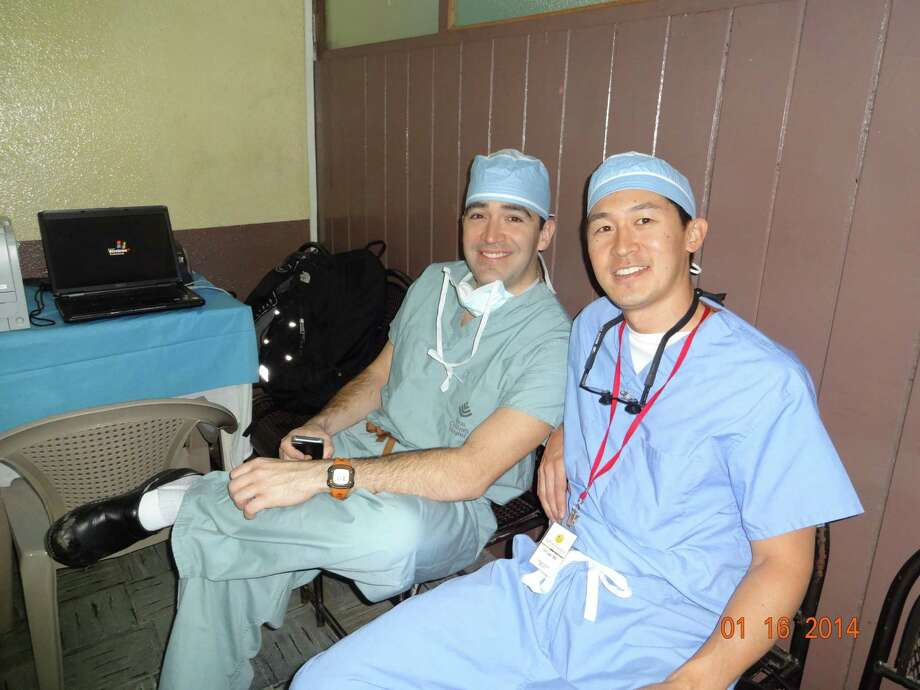 Surgeons Ruben Rodriguez, left, and Tim Lee spent a rare moment relaxing during their recent trip to Guatemala to provide treatment to children in impoverished families. Photo: Courtesy Tim Lee