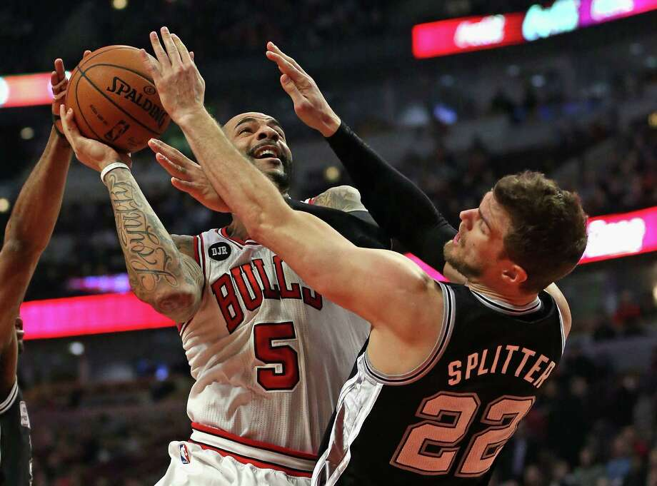 CHICAGO, IL - MARCH 11: Carlos Boozer #5 of the Chicago Bulls fouls Tiago Splitter #22 of the San Antonio Spurs at the United Center on March 11, 2014 in Chicago, Illinois. NOTE TO USER: User expressly acknowledges and agrees that, by downloading and or using this photograph, User is consenting to the terms and conditions of the Getty Images License Agreement. Photo: Jonathan Daniel, Getty Images / 2014 Getty Images
