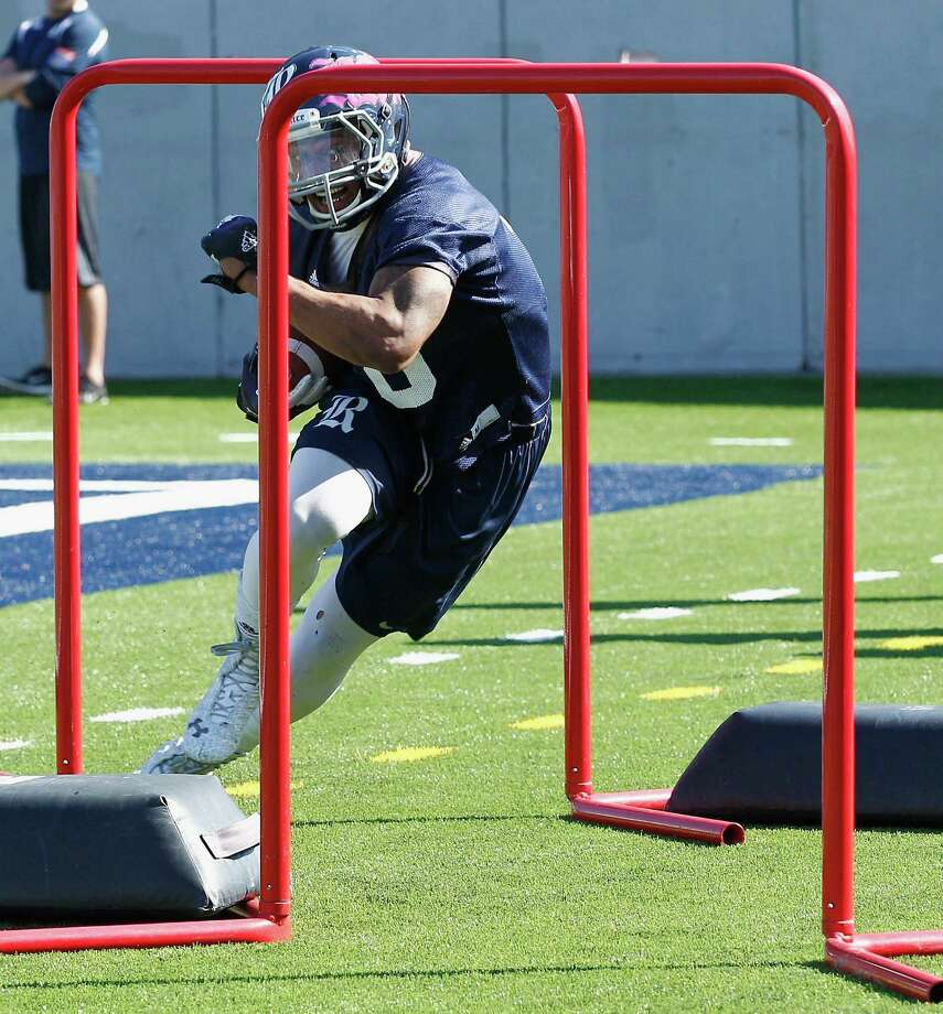 Rice Owls wide receiver Derek Brown (8) goes through drills during Rice's first spring football practice on Tuesday, March 11, 2014. (Bob Levey/For The Chronicle) Photo: Bob Levey, Houston Chronicle / ©2014 Bob Levey
