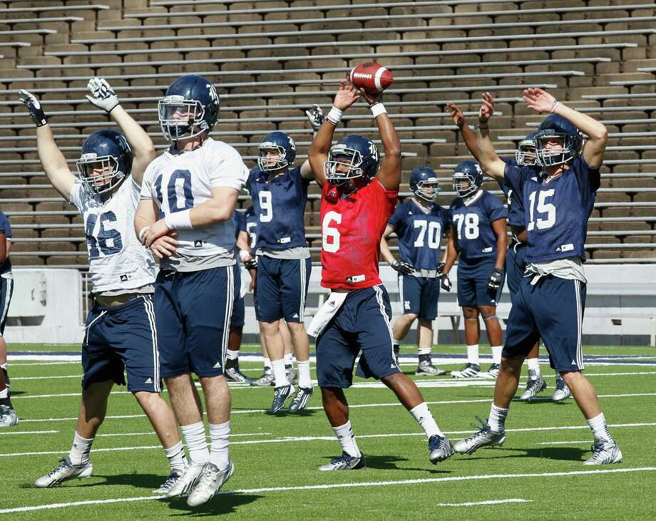 Rice Owls quarterback Driphus Jackson (6) along with  wide receiver Jordan Taylor (15), linebacker James Radcliffe (10) and linebacker Nick Elder (46) warm up before during Rice's first spring football practice on Tuesday, March 11, 2014. (Bob Levey/For The Chronicle) Photo: Bob Levey, Houston Chronicle / ©2014 Bob Levey