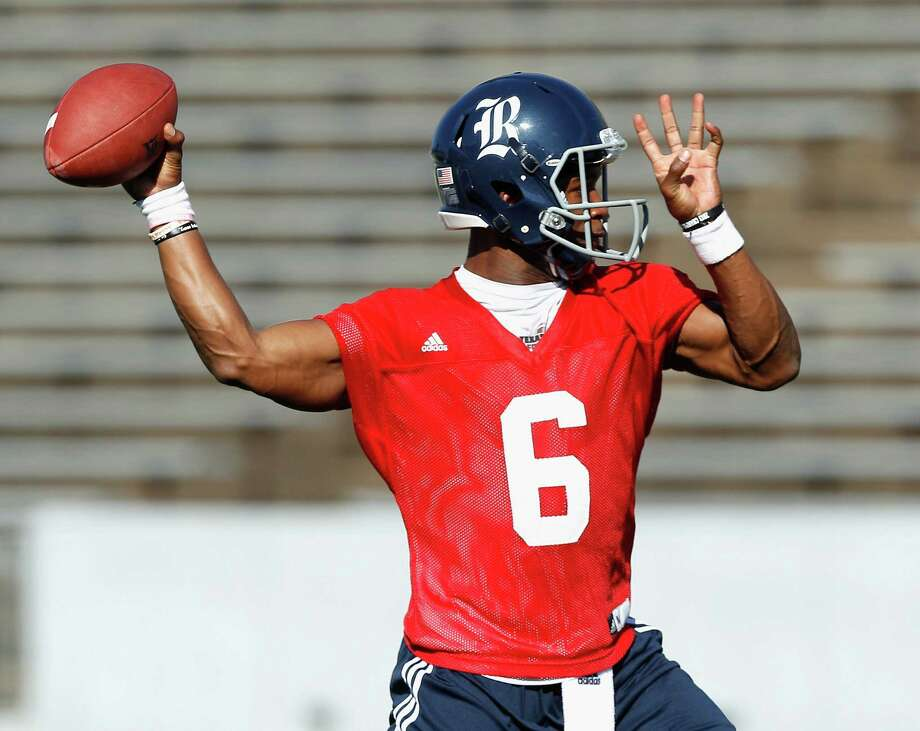 Rice Owls quarterback Driphus Jackson (6) throws the ball during Rice's first spring football practice on Tuesday, March 11, 2014. (Bob Levey/For The Chronicle) Photo: Bob Levey, Houston Chronicle / ©2014 Bob Levey