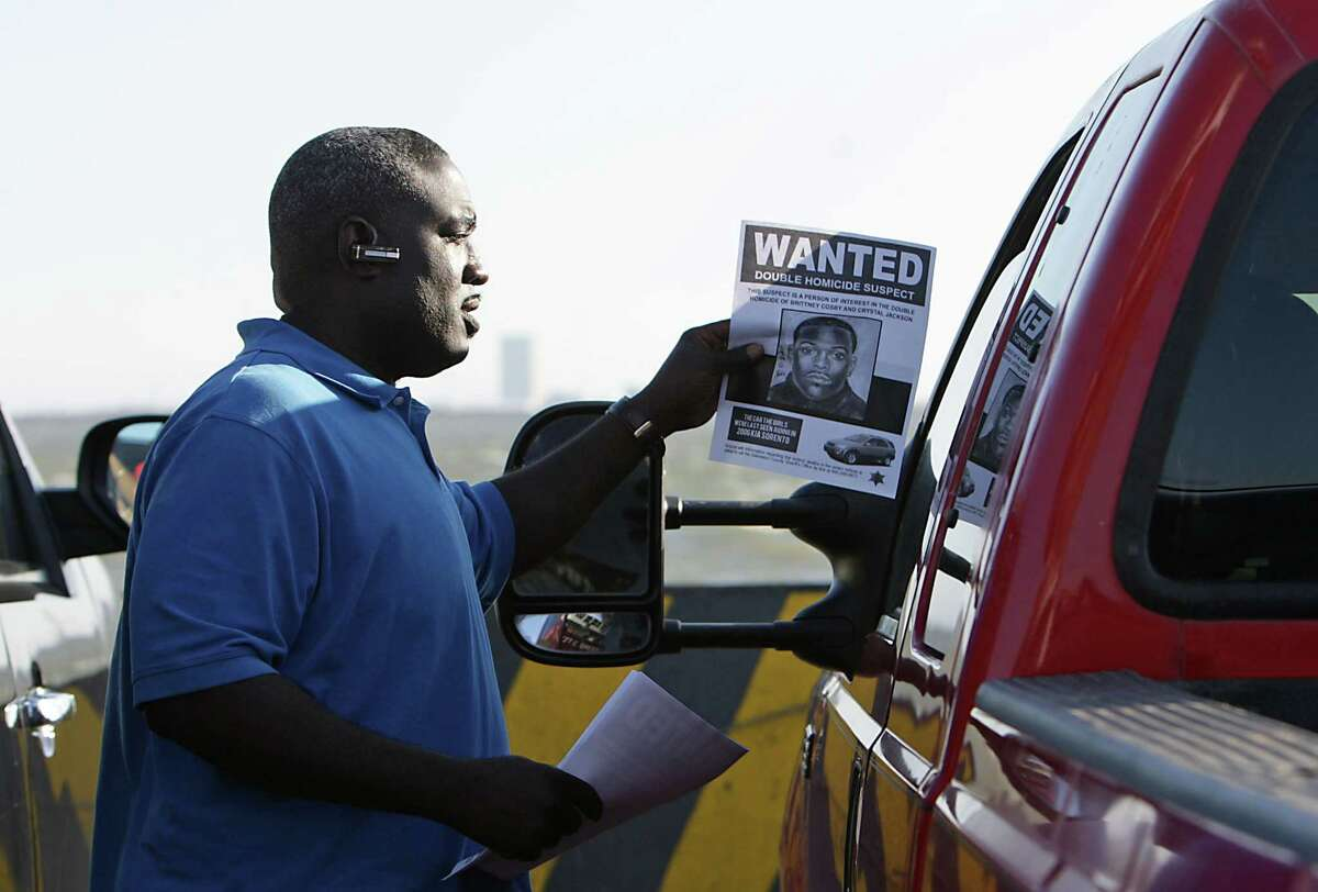 John Cooks hands out a wanted flier in the double homicide of Crystal Jackson and Britney Cosby.
