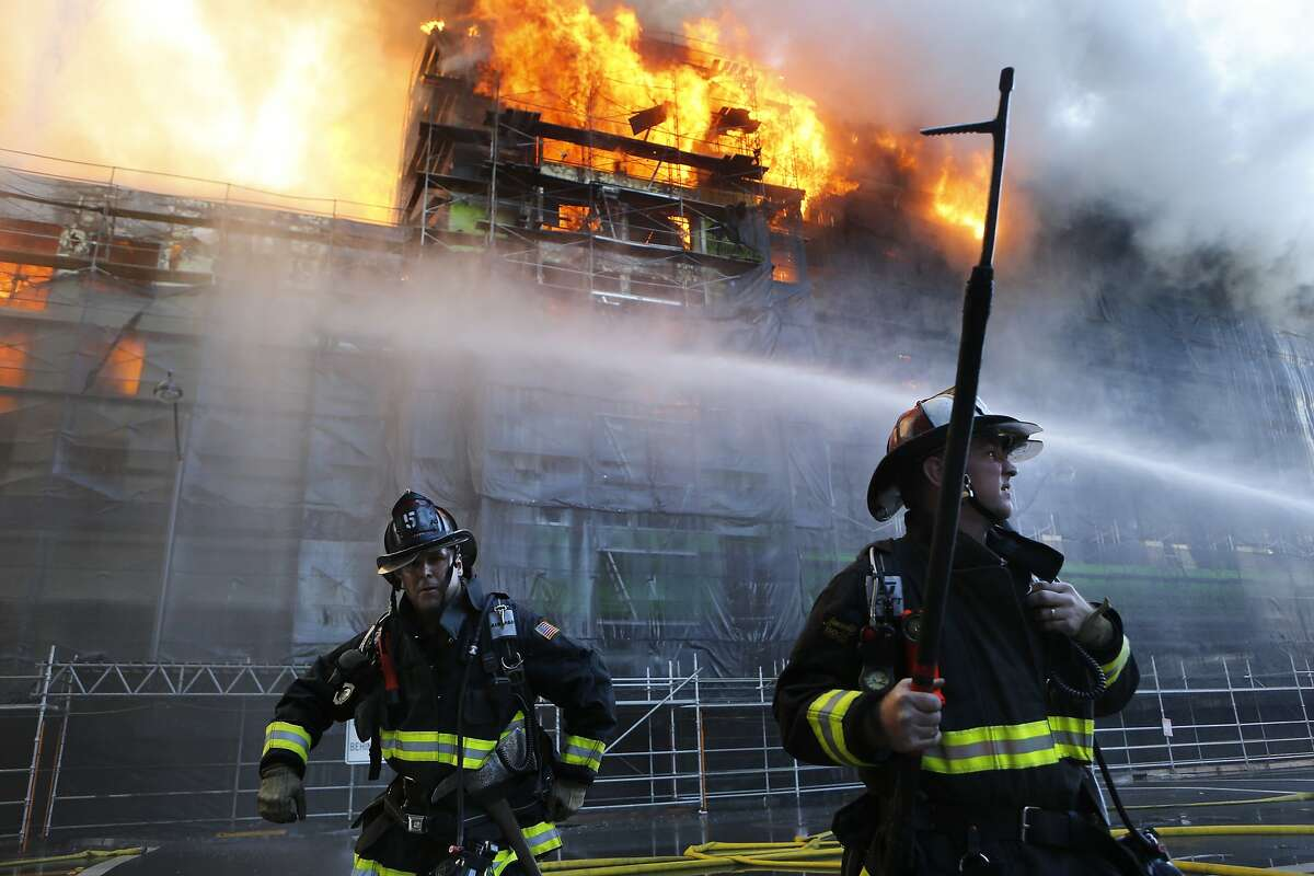 San Francisco firefighters battle a five alarm fire at a fire in the Mission Bay area of San Francisco, Calif. on Tuesday March 11, 2014.