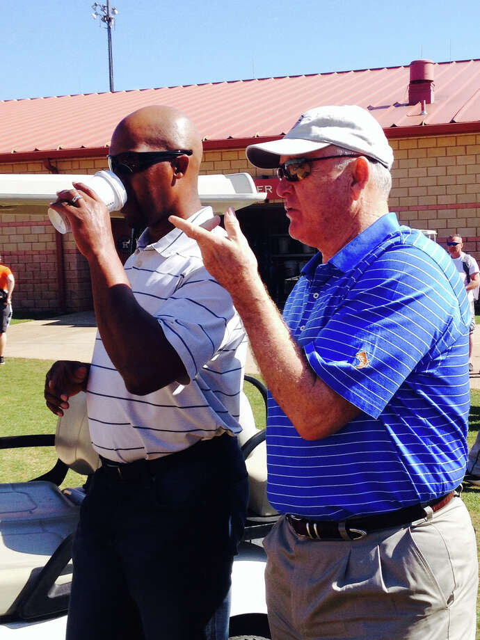 Astros manager Bo Porter, left, and Nolan Ryan watch workouts on Tuesday, a day off for the major league team.