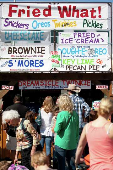 The lines are long at the Fried What! booth at the Houston Livestock Show and Rodeo carnival area ou