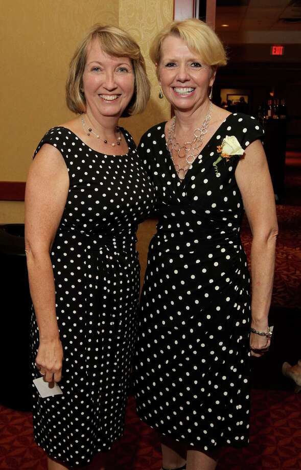 Troy, NY - September 19, 2013 - (Photo by Joe Putrock/Special to the Times Union) - Rensselaer County Executive Kathy Jimino(left) and Rensselaer County Regional Chamber of Commerce President Linda Hillman(right) didn't plan their matching dresses during the Van Rensselaer Awards Dinner presented by the Rensselaer County Regional Chamber of Commerce. ORG XMIT: 10 Photo: Joe Putrock / Joe Putrock