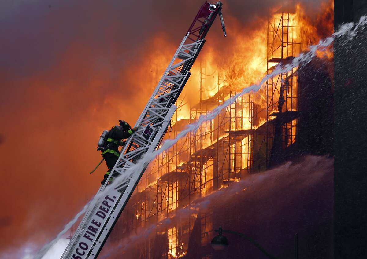 San Francisco firefighters battle a five alarm fire in the Mission Bay area of San Francisco, Calif. on Tuesday March 11, 2014.