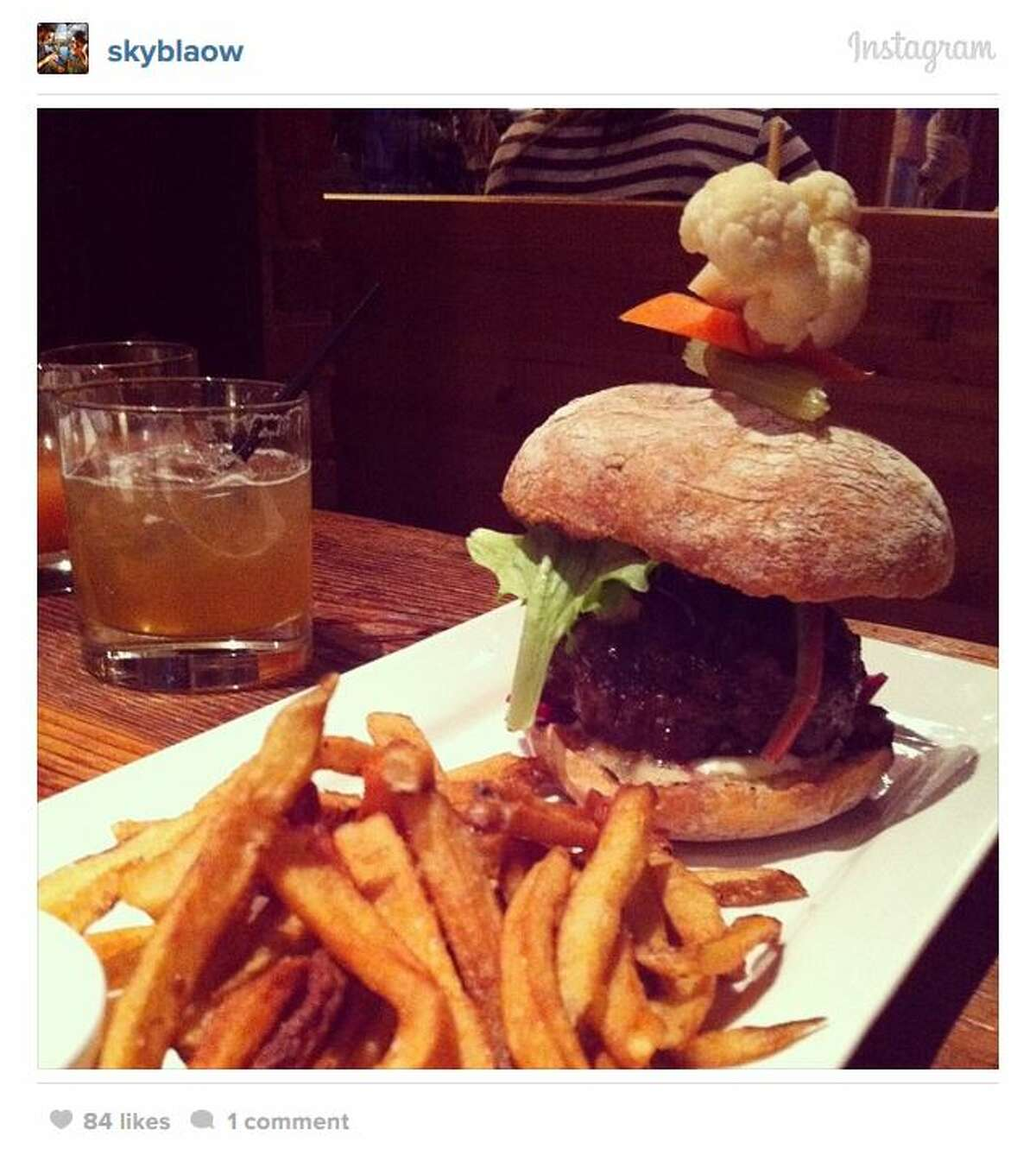 Terra Plata : Rooftop dining, Monday night paella, and marrow on crostini make this place foodie heaven. Pictured is the water buffalo burger with house-made chips. The drink is a chai-maple soda. 1401 Melrose Ave., Capitol Hill. Photo: skyblaow, Instagram.