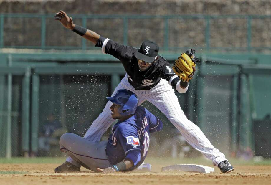 The Rangers' Jurickson Profar is tagged out at second by White Sox shortstop Alexei Ramirez on a steal attempt in Glendale, Ariz. Profar went 1 for 3 with a single in Texas' loss. Photo: Mark Duncan / Associated Press / AP