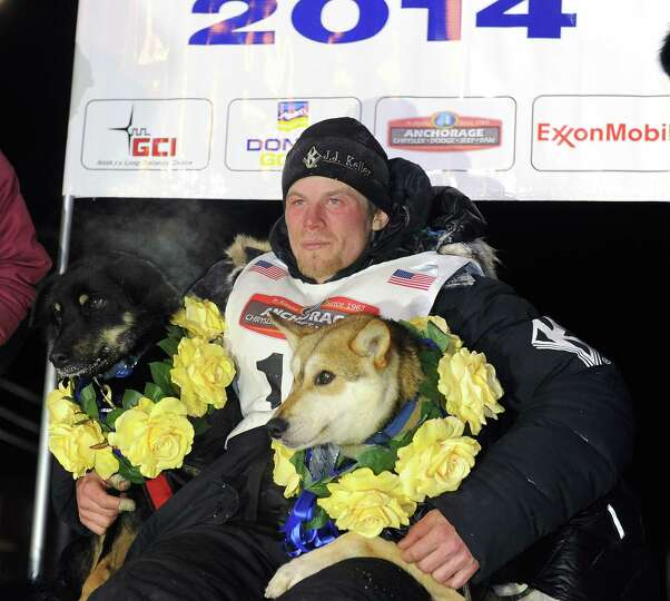 Dallas Seavey sits under the burled arch in Nome, Alaska after winning the 2014 Iditarod Trail Sled