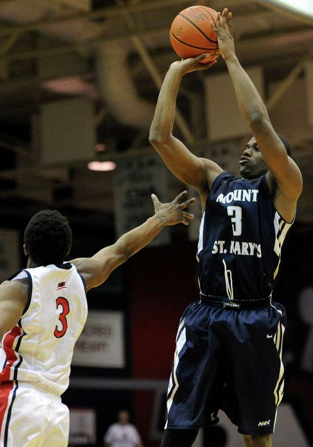 Mount St. Mary's' Sam Prescott, right, shoots over Robert Morris' Kavon Stewart (3) during the second half of the Northeastern Conference championship NCAA college basketball game on Tuesday, March 11, 2014, in Coraopolis, Pa. Mt. Saint Mary won 88-71.(AP Photo/Don Wright) ORG XMIT: PADW104 Photo: Don Wright / FR87040 AP