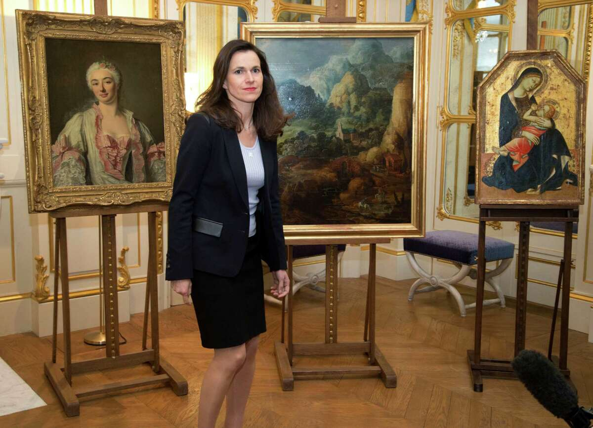 France's culture minister, Aurelie Filipetti, presides at a ceremony in the Culture Ministry in Paris to return three paintings taken from their owners in World War II.