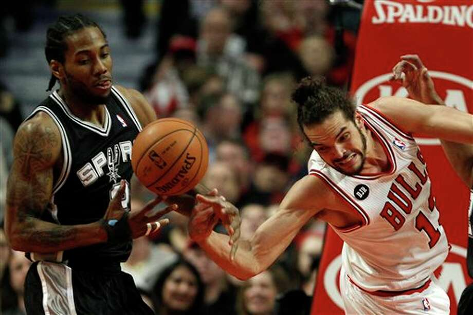 Chicago Bulls center Joakim Noah, right, loses the ball to San Antonio Spurs small forward Kawhi Leonard (2) during the first half of an NBA basketball game on Tuesday, March 11, 2014, in Chicago. (AP Photo/Andrew A. Nelles) Photo: Andrew Nelles, AP / FR170974 AP