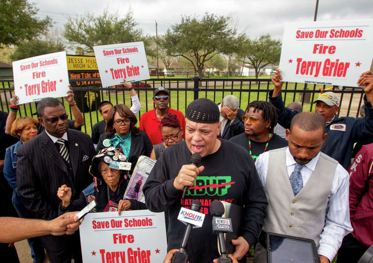 National Black United Front chairman Kofi Taharka speaks during a protest outside Jones High School, Tuesday, March 11, 2014. The group was protesting a school closure proposal announced by Houston ISD.
