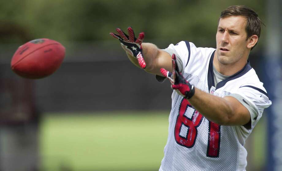 Tight end Owen Daniels played eight seasons with the Texans but missed 12 games last season with a fractured fibula. He failed a physical and was let go Tuesday. Photo: Brett Coomer / Houston Chronicle / © 2013  Houston Chronicle