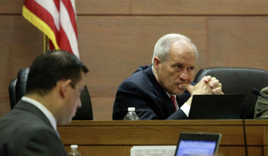 Outgoing Commissioner Tommy Adkisson listens as opponents of the streetcar address Commissioners Court during the public comment period of the court's first post-primary meeting. Photo: Photos By Helen L. Montoya / San Antonio Express-News / SAN ANTONIO EXPRESS-NEWS
