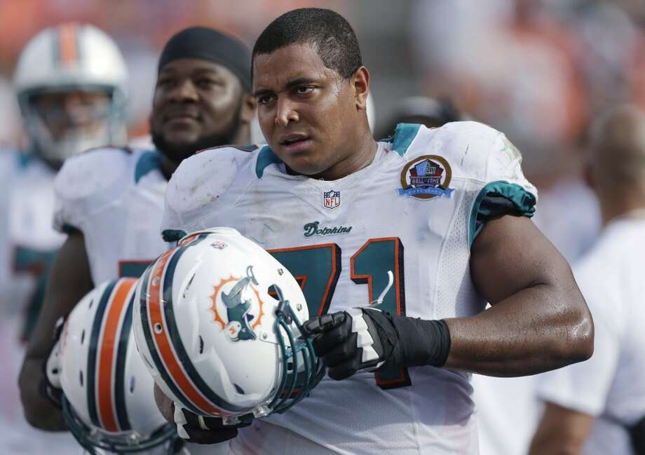 In this Dec. 16, 2012, photo, Miami Dolphins tackle Jonathan Martin stands on the sidelines during the Dolphins' game against the Jacksonville Jaguars in Miami. Martin, the offensive tackle at the center of the Dolphins' bullying scandal, has been traded to the San Francisco 49ers. The Dolphins announced the deal Tuesday night, March 11, 2014, on the first day of NFL free agency. Martin's move cross country brings him back to the Bay Area to be reunited with his former Stanford coach, Jim Harbaugh. Photo: Wilfredo Lee, Associated Press