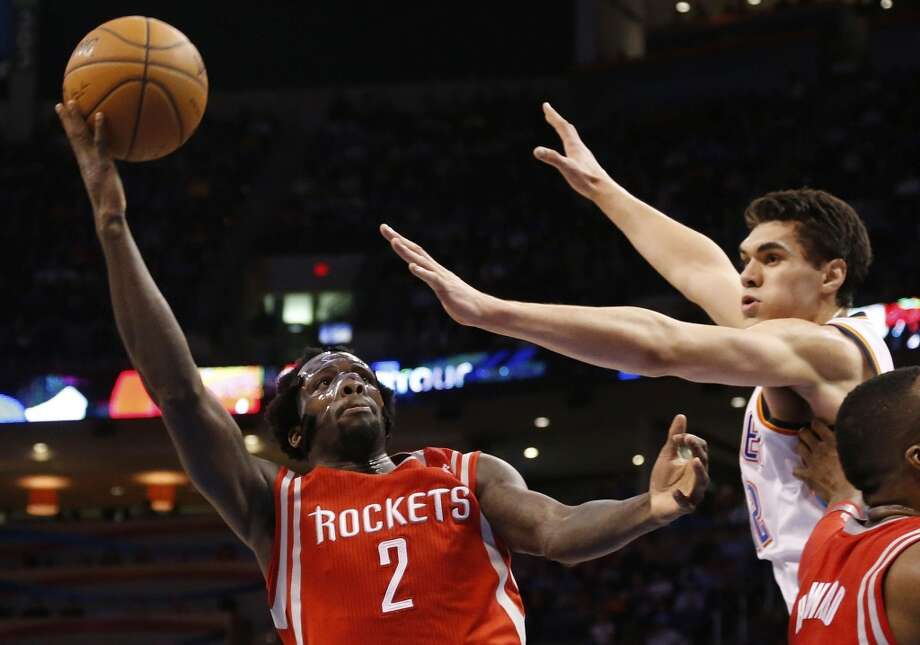 March 11: Thunder 106, Rockets 98  Rockets point guard Pat Beverley attempts a shot over Steven Adams of the Thunder. Photo: Sue Ogrocki, Associated Press