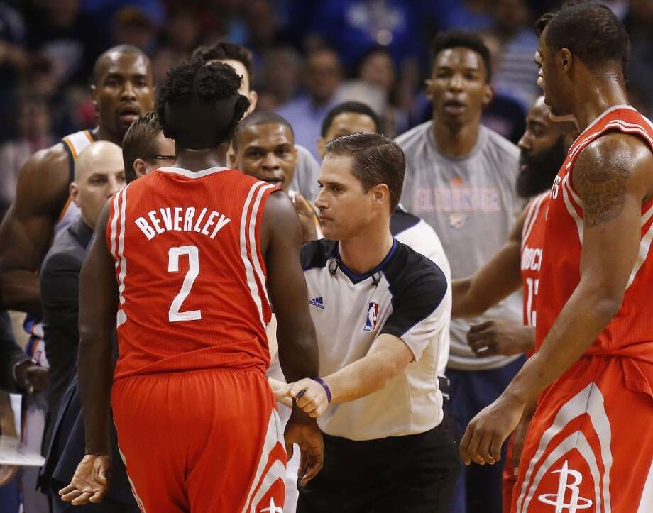 Rockets point guard Pat Beverley has to be separated from Russell Westbrook of the Photo: Sue Ogrocki, Associated Press
