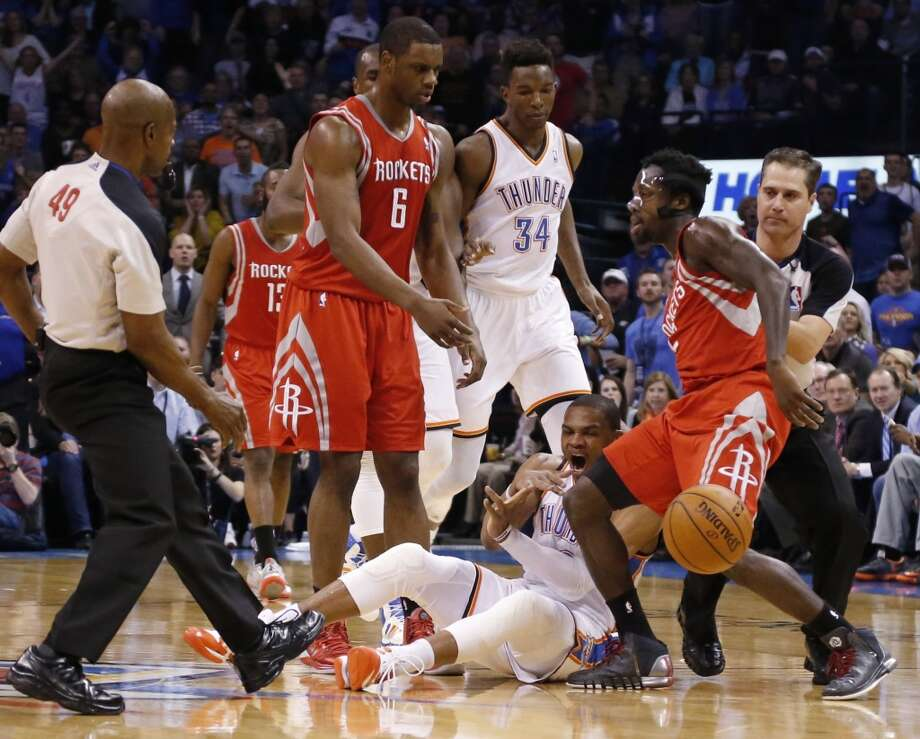 Thunder point guard Russell Westbrook reacts after a foul from Pat Beverley of the Rockets. Photo: Sue Ogrocki, Associated Press