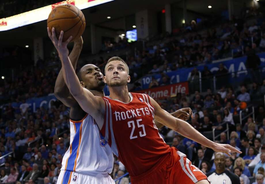 Rockets forward Chandler Parsons attempts a shot against the Thunder. Photo: Sue Ogrocki, Associated Press