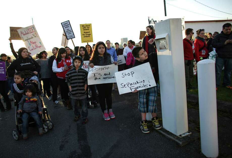 Sergio Gil, 9, pushes the call button at the privately-run Tacoma Northwest Detention Center which houses U.S. Immigration and Customs Enforcement detainees. A group of detainees in the facility are on the fifth day of a hunger strike. Family members and supporters have been gathering outside the facility to call for immigration reform and better treatment of the detainees. Photographed on Tuesday, March 11, 2014. Photo: JOSHUA TRUJILLO, SEATTLEPI.COM / SEATTLEPI.COM
