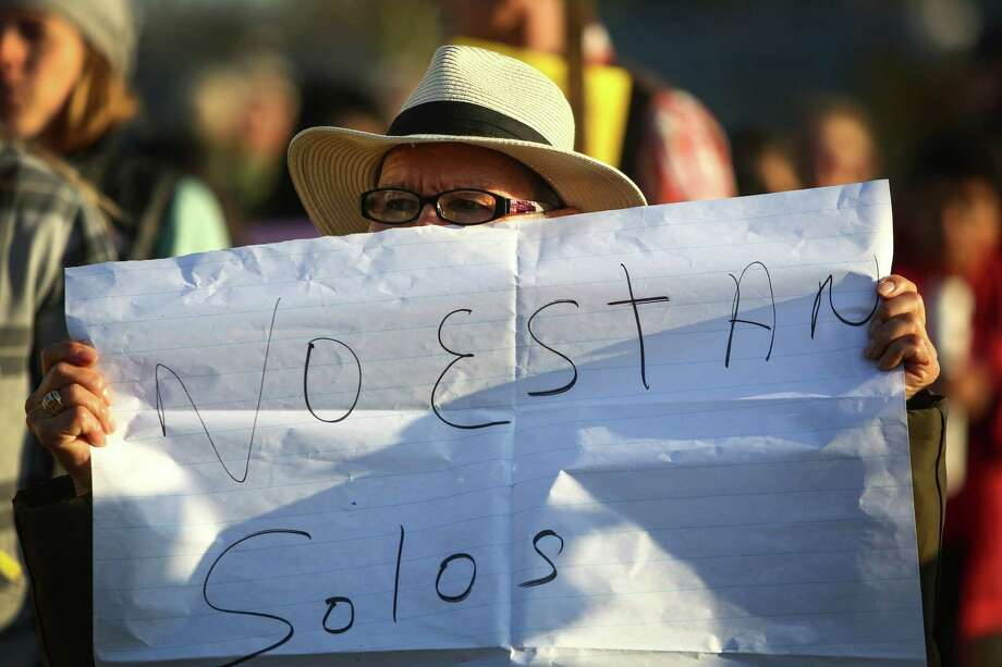 A supporter holds a sign outside the privately-run Tacoma Northwest Detention Center which houses U.S. Immigration and Customs Enforcement detainees. Daniela and her family believed her dad, Guillermo Gil was aboard the bus to be deported to Mexico. Guillermo Gil lived in the U.S. as an undocumented immigrant for 20 years before being detained in October of 2013. A group of detainees in the facility are on the fifth day of a hunger strike. Family members and supporters have been gathering outside the facility to call for immigration reform and better treatment of the detainees. Photographed on Tuesday, March 11, 2014. Photo: JOSHUA TRUJILLO, SEATTLEPI.COM / SEATTLEPI.COM