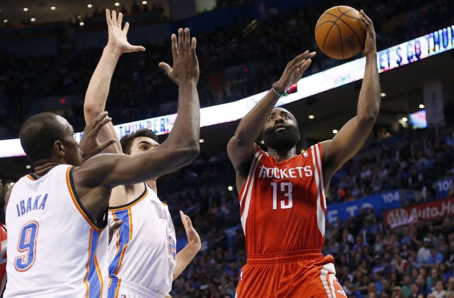 Rockets shooting guard James Harden attempts a shot against the Thunder. Photo: Sue Ogrocki, Associated Press