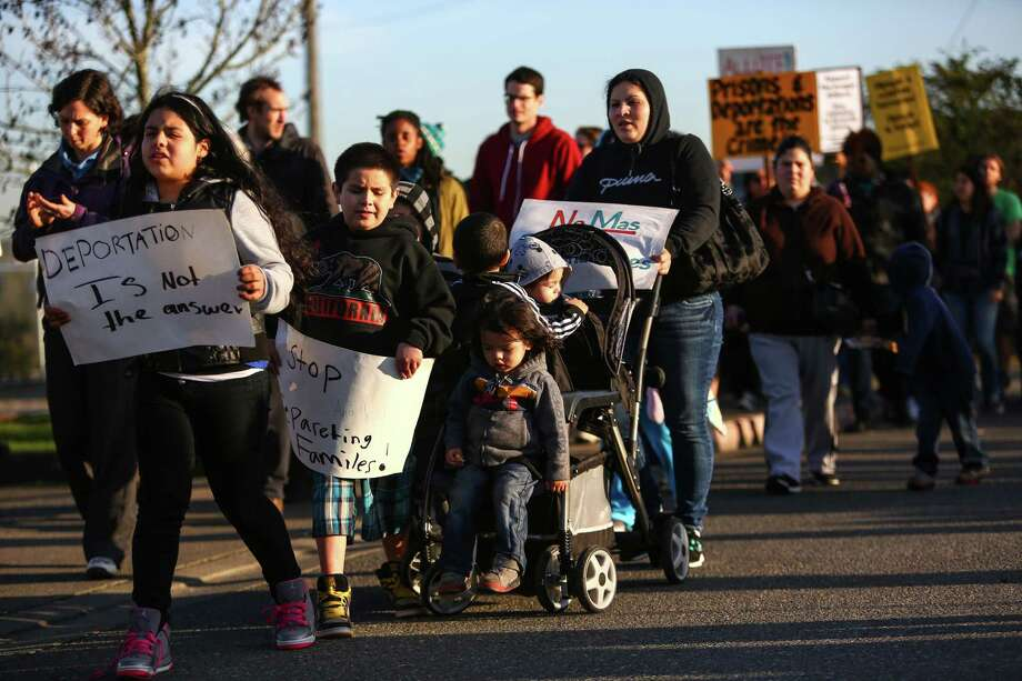Family members and supporters of detainees march outside the privately-run Tacoma Northwest Detention Center which houses U.S. Immigration and Customs Enforcement detainees. A group of detainees in the facility are on the fifth day of a hunger strike. Family members and supporters have been gathering outside the facility to call for immigration reform and better treatment of the detainees. Photographed on Tuesday, March 11, 2014. Photo: JOSHUA TRUJILLO, SEATTLEPI.COM / SEATTLEPI.COM