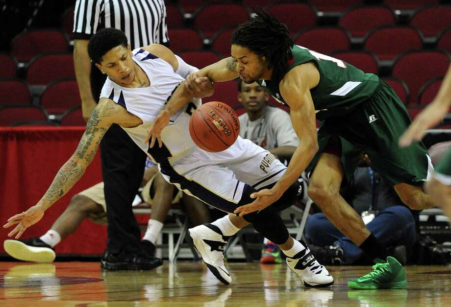 Prairie View's Louis Munks, left, and Mississippi Valley State's Ervin Thomas scramble for a loose ball during the second half Tuesday night. Photo: Eric Christian Smith, Freelance