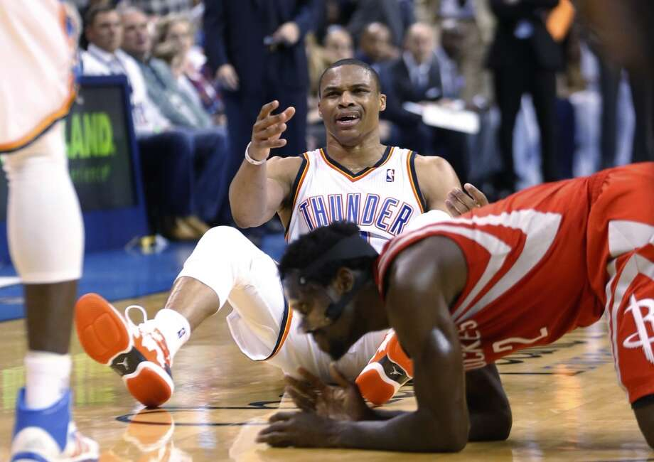 Russell Westbrook of the Thunder reacts after being fouled by Rockets point guard Pat Beverley. Photo: Sue Ogrocki, Associated Press
