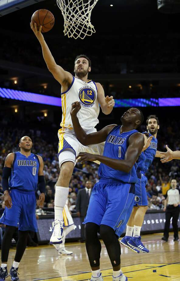 Center Andrew Bogut drives to the basket in the first half for two of his 15 points. Photo: Carlos Avila Gonzalez, The Chronicle