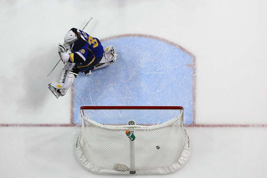Goalie Ryan Miller allows Jamie Benn's overtime goal, giving Miller his first loss with the Blues. Photo: Dilip Vishwanat, Getty Images