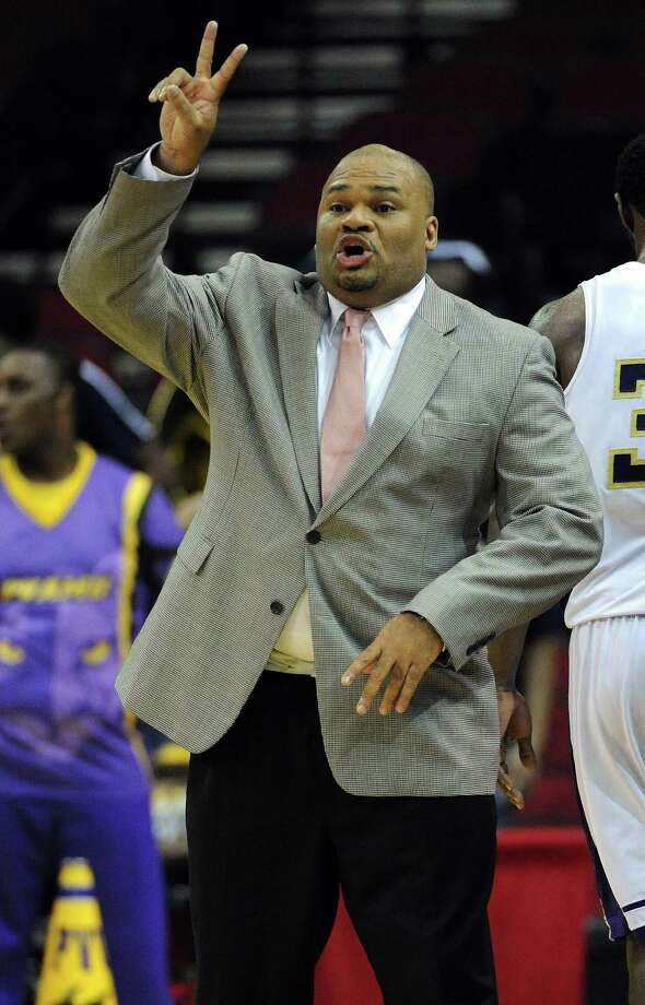 Prairie View A&M head coach Byron Rimm yells instructions from the bench during the first half of the first round of the SWAC basketball tournament against Mississippi Valley State, Tuesday, March 11, 2014, at Toyota Center in Houston. Photo: Eric Christian Smith, For The Chronicle