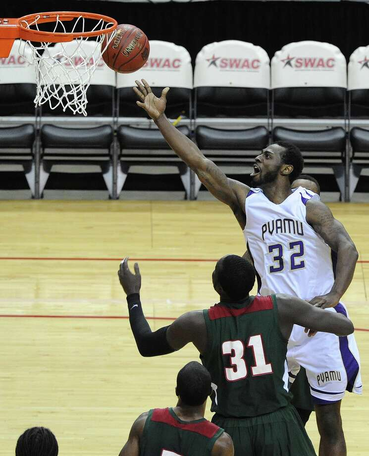 Prairie View A&M's Demondre Chapman (32) shoots over Mississippi Valley State's Julius Francis (31) during the first half of the first round of the SWAC basketball tournament, Tuesday, March 11, 2014, at Toyota Center in Houston. Photo: Eric Christian Smith, For The Chronicle