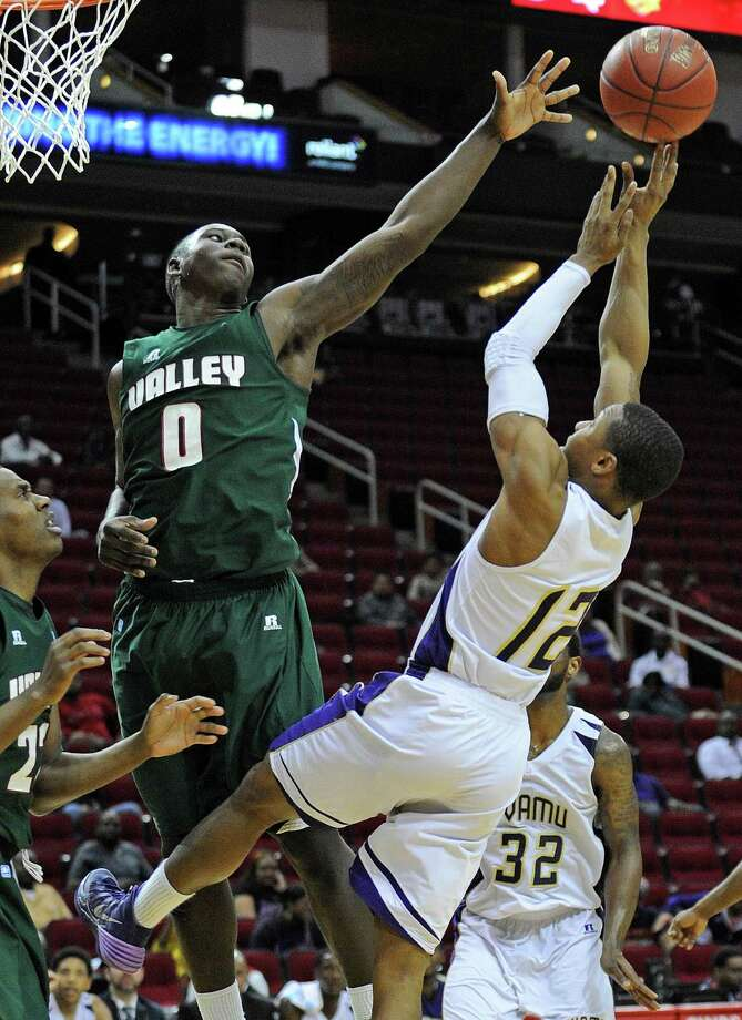 Prairie View A&M's John Brisco, right, shoots as Mississippi Valley State's Vacha Vaughn (0) defends during the second half of the first round of the SWAC basketball tournament, Tuesday, March 11, 2014, at Toyota Center in Houston. Photo: Eric Christian Smith, For The Chronicle