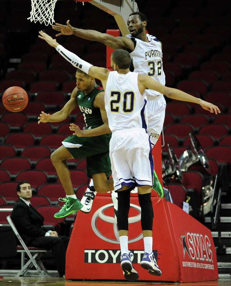 Mississippi Valley State's Jordan Washington, left, passes the ball past a defending Jules Montgomery (20) and Demondre Chapman (32) during the second half of the first round of the SWAC basketball tournament, Tuesday, March 11, 2014, at Toyota Center in Houston. Photo: Eric Christian Smith, For The Chronicle