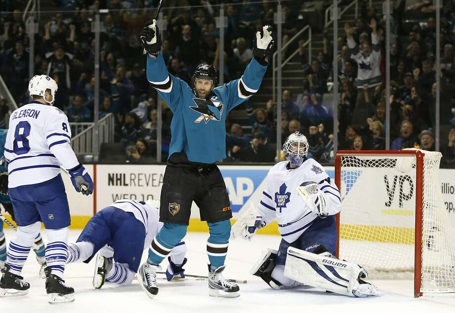 Mar 11, 2014; San Jose, CA, USA; San Jose Sharks center Joe Thornton (19) celebrates as the puck goes past Toronto Maple Leafs goalie James Reimer (34) on a first period score by San Jose Sharks right wing Brent Burns (88), not in picture, at SAP Center at San Jose. Mandatory Credit: Bob Stanton-USA TODAY Sports Photo: Robert Stanton, Reuters