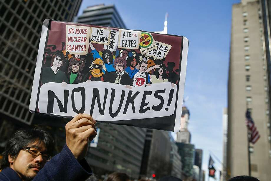A demonstrator holds a sign during a protest against nuclear power on the anniversary of the March 11, 2011 Fukushima earthquake and tsunami that killed thousands in Japan, outside the Consulate of Japan in New York March 11, 2014. REUTERS/Shannon Stapleton  (UNITED STATES  - Tags: ANNIVERSARY DISASTER CIVIL UNREST) Photo: Shannon Stapleton, Reuters