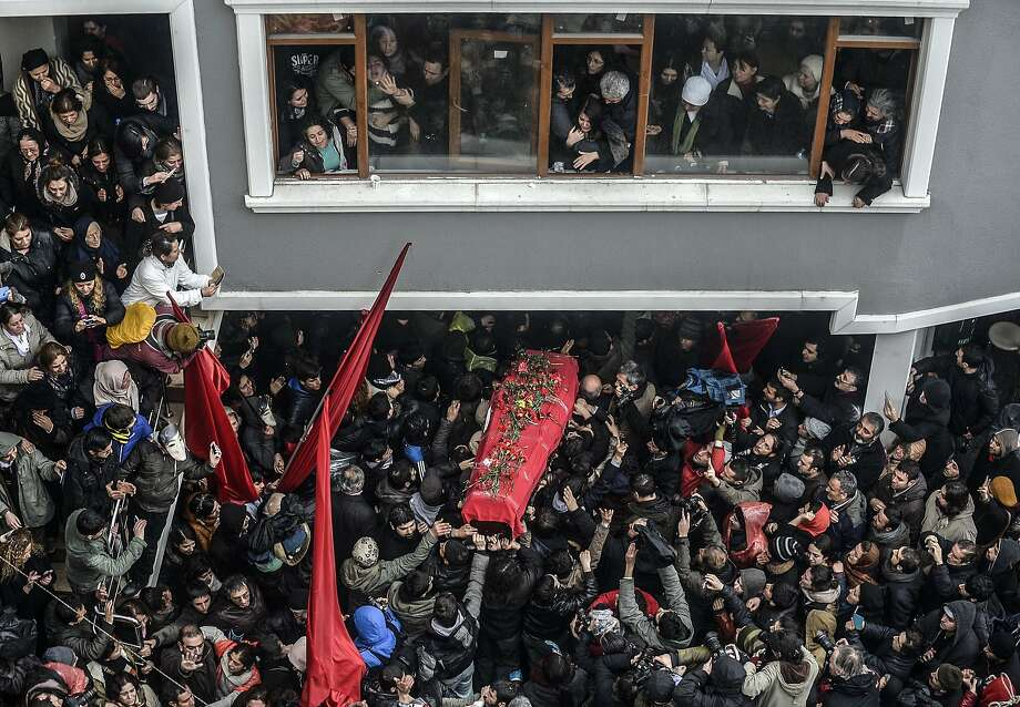 TOPSHOTS The coffin of Berkin Elvan is carried   on March 11, 2014, in Istanbul. Berkin Elvan, who has been in a coma since June 2013 after being struck in the head by a gas canister during a police crackdown on protesters, died March 11, his family announced via Twitter. The young teenager, the eighth person to be killed in the Gezi Park protests, went into a coma after sustaining a head injury from a gas canister as he went to buy bread during a police crackdown in Istanbul's Okmeydanõ neighborhood last June. Elvan has since become one of the prime symbols violence faced by protesters throughout the nationwide Gezi demonstrations. AFP PHOTO/BULENT KILICBULENT KILIC/AFP/Getty Images Photo: Bulent Kilic, AFP/Getty Images