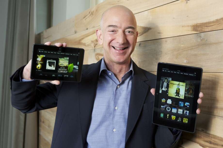 "Founded in 1994 by Jeff Bezos, pictured, Amazon.com has changed the way we shop, read books, and more. The website sold its first book in 1995, called ""Fluid Concepts & Creative Analogies: Computer Models of the  Fundamental Mechanisms of Thought."" Photo: Stephen Brashear, Associated Press"